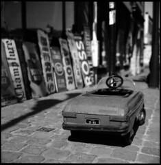 lil' car  brussels, belgium  2011 (lem's) Tags: street brussels signs car advertising children miniature belgium belgique belgie bruxelles voiture bronica enfants pubs rue paved plaques pedales marolles zenza pave