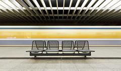 An Empty Seating Bench (yushimoto_02 [christian]) Tags: urban art station architecture speed canon germany underground subway munich mnchen geotagged movement arquitectura europe metro transport tube tunnel symmetry ubahn olympia architektur convergence munchen bahn hdri architectura interiorarchitecture olympiazentrum convergency konvergieren