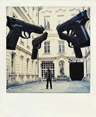 4 guns 3973 (s.alt) Tags: polaroid prague prag praha praga exhibition praag czechia davidcerny esko tchquie poladroid cechia davidern poladroidonized