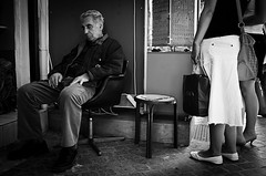 Sleeping At Work.. (Peter Levi) Tags: street city blackandwhite bw man blancoynegro shop cityscape sweden stockholm streetphotography documentary greece crete chania manasleep x100 fujifilmfinepixx100
