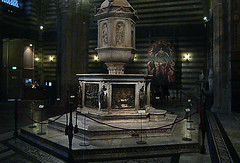 Baptismal font with Donatello's Feast of Herod