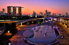 Marina Barrage, Singapore (Rebecca Ang) Tags: lighting city longexposure blue light orange color fountain colors wheel architecture mari