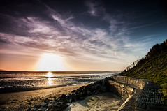 Sunset at Caldy (Colin Freeman Photography) Tags: blue light sunset sea sky cloud sun reflection beach nature water grass rock stone wall fence river landscape evening sand nikon dof cheshire path tokina trail dee armour defence wirral mkii merseyside caldy heswall d90 1116