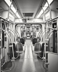 Metro ride from Minneapolis to Mall of America, Bloomington ('SandFlash) Tags: train metro empty transport minneapolis rail symmetry commute commuter publictransport bnw