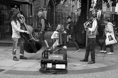In harmony: busking in Oxford, England (Dai Lygad) Tags: street city uk greatbritain england people urban blackandwhite bw musician music woman white man black men smile musicians canon geotagged photography eos photo flickr image noiretblanc unitedkingdom britain pavement expression group may picture pedestrian streetscene accordion human together photograph violin oxford buskers instrument busker everyday instruments busking bankholiday collaboration doublebass eyecatching collaborate 2016 cornmarketstreet workingtogether 550d cornmarketst inharmony