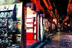 Mao at the shops (greenwood100) Tags: cobblestones yunnan cobbles lijiang chairmanmao gucheng maoposter