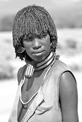 Hamer Woman, #1: A First Wife (**El-Len**) Tags: africa portrait blackandwhite woman monochrome necklace earring jewelry omovalley braids ethiopia tribe ethnic hairstyle hamar hamer eastafrica fav10 neckband firstwife snnpr thegalleryoffinephotography southernnationsnationalitiesandpeoplesregion