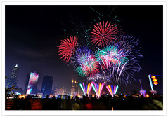 4888 - 2012 .      .          85 - Kaohsiung Lantern Festival with Fireworks . Waterdance . Loveriver & Glory Pier . Kaohsiung City .Taiwan (deepblue68) Tags: world life city carnival light shadow people color love water festival night landscape photography harbor pier photo scenery asia tour image fireworks harbour glory scenic culture taiwan explore vision kaohsiung lighttrails lantern formosa   celebrate     2012 loveriver             85  waterdance   peterchen   kaohsiungcity           deepblue68