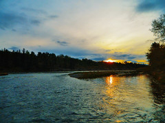 Sun Sinks Into Water (LostMyHeadache: Absolutely Free *) Tags: sunset summer sky nature water clouds reflections river evening spring twilight nikon glow dusk horizon davidsmith calgaryalbertacanada