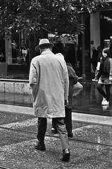 Forward (Smith-Bob) Tags: people bw woman man wet hat rain walking blackwhite crossing candid melbourne blacknwhite elderlygentleman matureperson