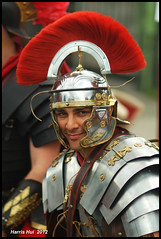 The Roman Legionary - Italian Day On Commercial Drive 8390e (Harris Hui (in search of light)) Tags: red italy canada colour vancouver colours fuji dof bc roman bokeh candid helmet streetphotography handsome 85mm streetportrait hairdo richmond fujifilm f18 littleitaly eastside armour commercialdrive handsomeman eurocup hairdress thedrive candidportrait vibrantcolour s3pro fixedlens primelens italianday fujis3pro nikon85mmf18 vancouvereastside romanlegionary harrishui vancouverdslrshooter eurocup2012 italyisgood
