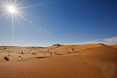 The Desert Under The Sun (TARIQ-M) Tags: canoneos5dmarkii desert dunes landscape riyadh sahara sand saudiarabia canonef1635mmf28liiusm wave waves ripples ripple patterns pattern texture sunlight sunrays sun rays cloud sky picture pictures photo photos image images lens