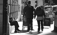 For the gentleman who has everything (AAcerbo) Tags: sanfrancisco california street city urban blackandwhite bw building feet sign walking shoes downtown sitting legs district homeless streetscene sneakers financial wingtip