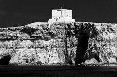 Watchtower (albireo 2006) Tags: blackandwhite bw tower castle blackwhite malta pb nb cliffs bn watchtower gozo comino blackandwhitephotos blackwhitephotos