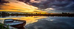 A burst of light (PhotoSolutions | pure photography) Tags: light sunset sun reflection nature water colors landscape mirror boat nikon colorful natuur linge d800 nohdr rhenoy