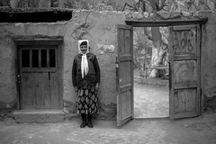 Housewife, Xinjiang,China (Keith211) Tags: china leica travel trees bw woman tree kids photography mono blackwhite kid village apricot xinjiang persons bwphotography bwphoto pepole blackwhitephoto outdoorphotograph leicam outdoorphotographer thepamirsmountain