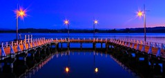 Dusky Wharf... (fotonut NZ) Tags: ohope wharf dusk outdoor water harbour sunset lights assymetrical bridge light hdr pier waterfront sky skyline landscape shore seaside
