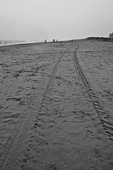 Marina (Kals Pics) Tags: sky people blackandwhite bw india beach monochrome rain clouds marina landscape miniature blackwhite sand nikon rainyday pov tracks wideangle shore 1855mm minimalism chennai colorless tyre cwc d40 kalspics chennaiweekendclickers tamilnaduperspective