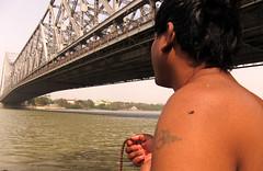The devotee (Rajib Singha) Tags: travel people india river interestingness searchthebest devotee kolkata westbengal rabindrasetu flickriver canonpowershots90