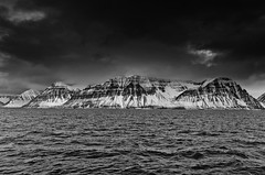 shlid (Axel R. verby) Tags: bw snow mountains iceland fishing banks fjords bwlandscape