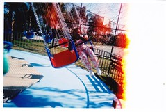 swing ride (Mrs. Nesbit) Tags: kid child swing disposablecamera swingride