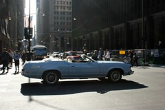 City Cat (Flint Foto Factory) Tags: auto street city blue light shadow urban baby white chicago motion building classic car wheel america vintage john illinois spring movement wire automobile downtown afternoon traffic loop mercury top interior flag vinyl may convertible powder jackson sidewalk american pedestrians 70s intersection covers rushhour 1970s pm cougar federal 1973 2012 dearborn ponycar fomoco 2door kluczynski slowride worldcars