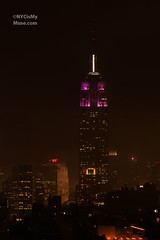 A brief break in the fog: Empire State Building in Purple & White For NYU (NYCisMyMuse) Tags: nyc newyorkcity white newyork fog skyline architecture purple manhattan foggy empirestatebuilding newyorkuniversity nyucommencement nycismymuse purplepurplewhite
