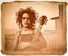 Baby Soul (JeezyDeezy) Tags: old musician texture sepia vintage child guitar antique afro 2012 week20 oldpaper week20theme 522012 52weeksthe2012edition weekofmay13