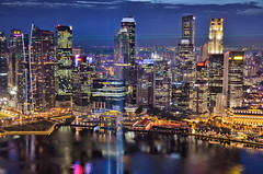 Singapore Skyline (roevin | Urban Capture) Tags: city longexposure trip bridge light red lake reflection water skyline marina buildings reflections dark lights hotel evening high singapore downtown skyscrapers nightshot floor district jetty illuminated business beams offices marinabaysands