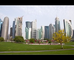 Doha the beauty (valooran-വാളൂരാന്‍) Tags: morning building tree green tower beauty grass corniche friday doha qatar kanikonna
