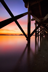 Under a Pier, a Sunset Over Boston (chris lazzery) Tags: longexposure sunset boston quincy massachusetts squantumpointpark canonef1740mmf4l 5dmarkii bw30nd
