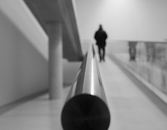 gone (Georgie Pauwels) Tags: blackandwhite public monochrome museum blurry geometry streetphotography olympus gone banister railing