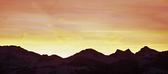 Sunset in the Mountains (David K. Marti) Tags: landscape mountain mountainscape mountaintop peak sky clouds mountainrange country countryside outdoors outdoor outside nature natural snow winter season seasonal silhouette black dark darkness light shadow sun sunlight sunset evening dusk color colored colorful colour yellow orange red glow glowing bright scenic scenery alps alpine widescreen scene travel europe european panorama majestic massive formation arete traveling travelling summit