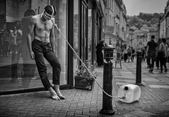 Street portait of a tethered man (Daz Smith) Tags: city uk portrait people urban blackandwhite bw streets art blancoynegro water monochrome canon naked blackwhite bath mask candid citylife thecity streetphotography bondage best topless second performer weight tethered dragging canon6d manmmale dazsmith bathstreetphotography