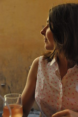 light lunch (Rising Damp) Tags: light summer portrait france glass girl beautiful smile mystery lunch golden glow cheek wine profile bistro mysterious