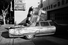 (AlanDejecacion) Tags: sanfrancisco california car junk vintagecar automobile cadillac missiondistrict nikonf ontheroad 2009 24thstreet americancar carculture fomapan400 nikkor3520 oldcadillac r09150