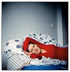 Portrait On Bed (CrissyTheRocket) Tags: b 6 120 6x6 girl canon square bed bett lomo kodak young x lubitel medium format 100 frau process dem auf canoscan mdchen junge 166 ektar c41 lomographie colourartaward 9000f