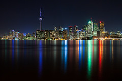 Skyline (tyler hayward) Tags: longexposure friends toronto ontario canada cold reflection jeff water ferry bulb night canon island lights eric downtown cityscape cntower skyscrapers harbour tripod nd usher 45mm pushed2stops tse lazysunday chirs almondcroissants filmscanning 5dmkii ikeaadventures sleepintillnoon damntheferryforcomingearly