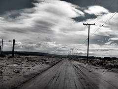 The Road Less Traveled in Lockhart (TheJudge310) Tags: california road sky usa clouds telephone pole dirt april thunderstorm hinkley 2012 canonpowershots95