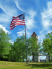 Its a Beautiful Day (junglejims photos) Tags: park blue sky usa tower clock clouds river stars photo washington spokane downtown photographer stripes flag front photograph american amateur