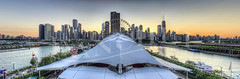 Chicago City Skyline Panorama (Dan Chui (on/off!)) Tags: city travel sunset sky urban panorama usa chicago water skyline architecture modern america buildings shopping geotagged fun evening bay us illinois dock nikon cityscape adobephotoshop skyscrapers famous citylife landmark tourists boardwalk ferriswheel amusementpark navypier 24mm development metropolitan hdr johnhancockbuilding watefront topaz  noiseware  photomatix niksoftware d700 willistower