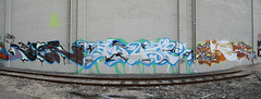 RIVER AQUA ERGOT (Reckless Artist) Tags: railroad urban panorama west building art abandoned minnesota st wall train canon river paul photography graffiti photo midwest aqua paint artist ipc graf cement champs tracks cities stpaul minneapolis twin panoramic spray mpls photograph tc production twincities graff burner mn minn mid inc ctw burners incorporated reckless tci pts tkg illest ergot ipctw recklessartist aerososol