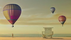 The drift of balloons over the beach (Suzanne takes you down) Tags: sea beach seaside hotairballoons
