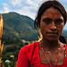 Portrait of a Nepali Dalit woman in her village overlooking the valley
