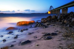 Am Sund (dubdream) Tags: ocean bridge blue sea water night germany rocks shoreline balticsea ostsee fehmarn schleswigholstein fehmarnsund colorimage a55 sonyalpha dubdream