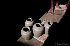 Symphony of Clay XII (Sopnochora) Tags: life smile work canon circle eos pattern hand with potter peoples story clay pottery shape bangladesh 1022mm circular 500d art people village canon people hand print village clay potter potter clay bangladesh circle pattern 500d sopnochora