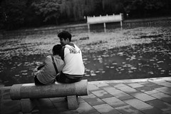 Love is.. (A. adnan) Tags: guangzhou china park bw love monochrome couple sitting lovers moment tilt lean unedited sooc nikon50mmf14 d700