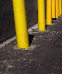 Brooklyn street (StartTheDay) Tags: street city nyc urban holiday yellow stone brooklyn america concrete us angle post bright sony pillar multiple safe travle bollard 2012 sonyalpha500
