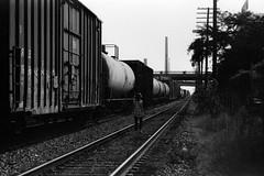 Train Tracks One (Colton Davie) Tags: bw film train 35mm birmingham downtown fuji iso400 traintracks august alexandra neopan400 2010 canoneoselan7 nikon50mmf14