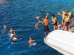 Swimming in the Red Sea (shaire productions) Tags: egypt egyptian vacation resort image hurghada boat cruise redsea city cityscape picture nature water boats sail sailing boating river diving scuba people swim swimming swimmers group crowd vacationers tourists tour tourism visitors